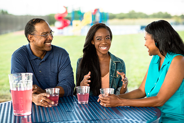 Family talking at picnic table