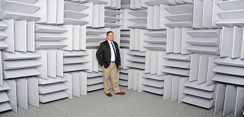 Chris Stecker stands inside the new anechoic chamber at Boys Town National Research Hospital