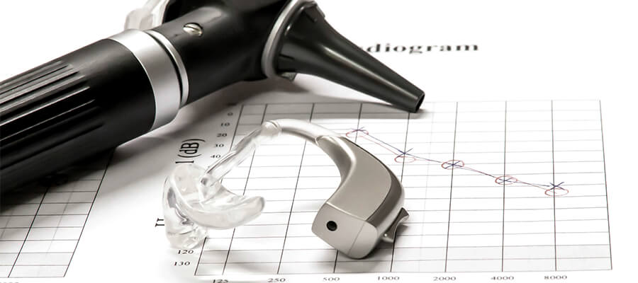 Audiologist tools on a medical chart