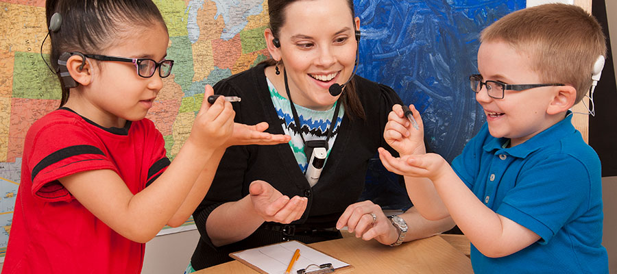 Deaf children in classroom with teacher