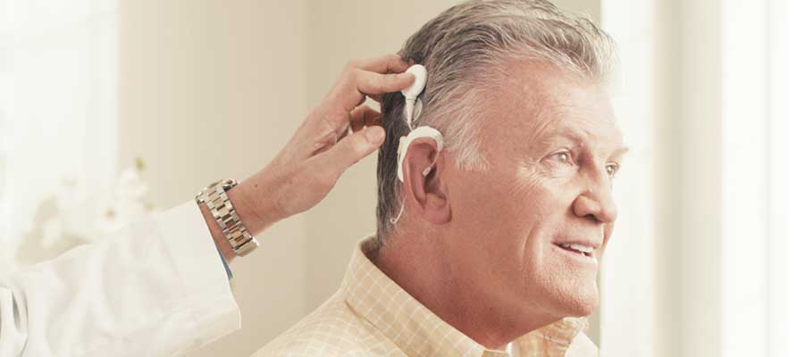 Man getting cochlear implant fitted