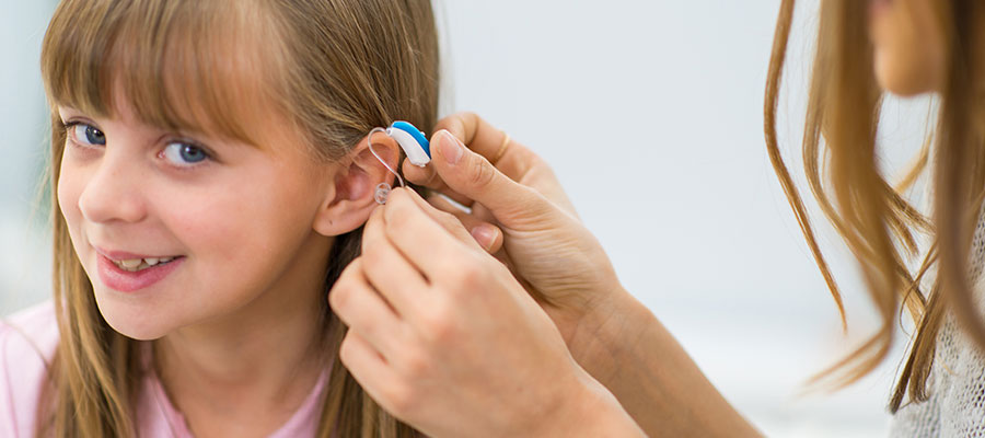 Little girl during hearing aid fitting