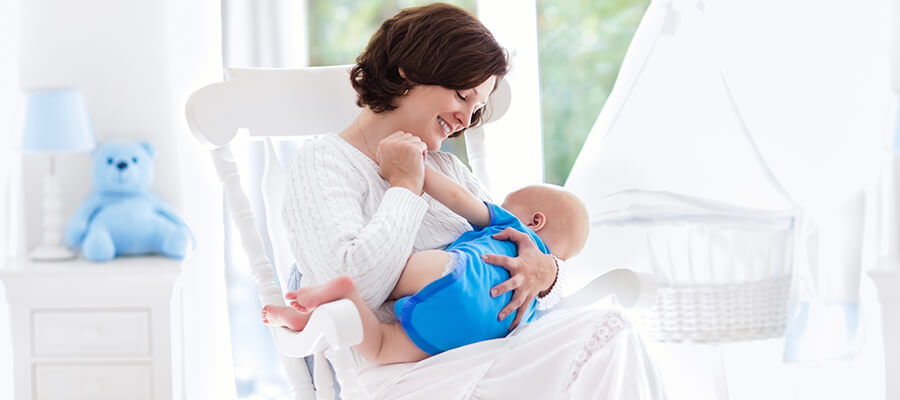 Woman breastfeeding newborn